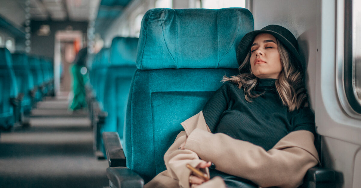 Young woman sleeping in the train